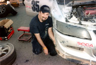 John's happiest place is building and racing cars.  Here he works on re-attaching the front bumper of the Muellerized Evo (boasting a dominating 2-Year SCCA ITE Class Championships with 24 consecutive wins) which he conceptualized, designed, built, tested, and refined with his Muellerized team.