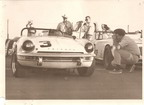 Jim supervises Dad and Jim Coan driving the spitfire to the pre grid, Daytona 1969.