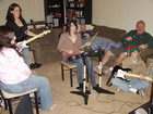 Caption w/ gramps and rock band party: From left, my sister Michelle, daughter Elizabeth, mom Lola, daughter Sarah, Grandpa Jim, brother in law Mark Senesac, nephew Jerrad Senesac focus on playing Rock Band together, Christmas 2008.