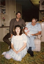 My father Lee, sister Michelle, and Grandpa Jim holding my nephew Ray, 1985.