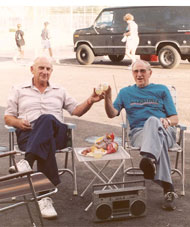 Jim and his brother Fred salute with manhattans after a Mueller charge thru the field at the Eloy Grand Prix of Arizona, 1989.