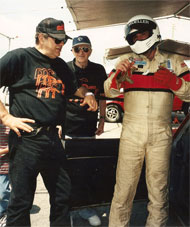 3 generations of John Mueller intensely discuss chassis set-up post race, Pomona road races 1998.