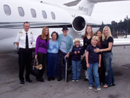Jim Mueller enjoying the company of family and friends after his flight to Laguna Seca, 2006.